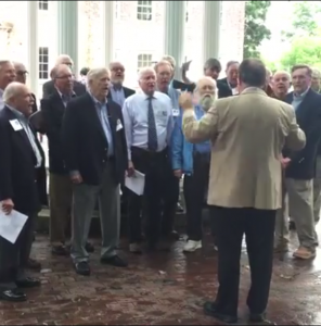 Former members of the UNC Men's Club sing Hark the Sound at the Old Well