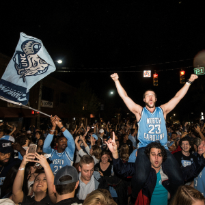 Photo of students rushing Franklin street after a Carolina victory