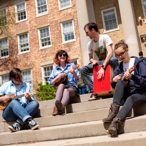 Group of ukulele players performing on the steps of South Building