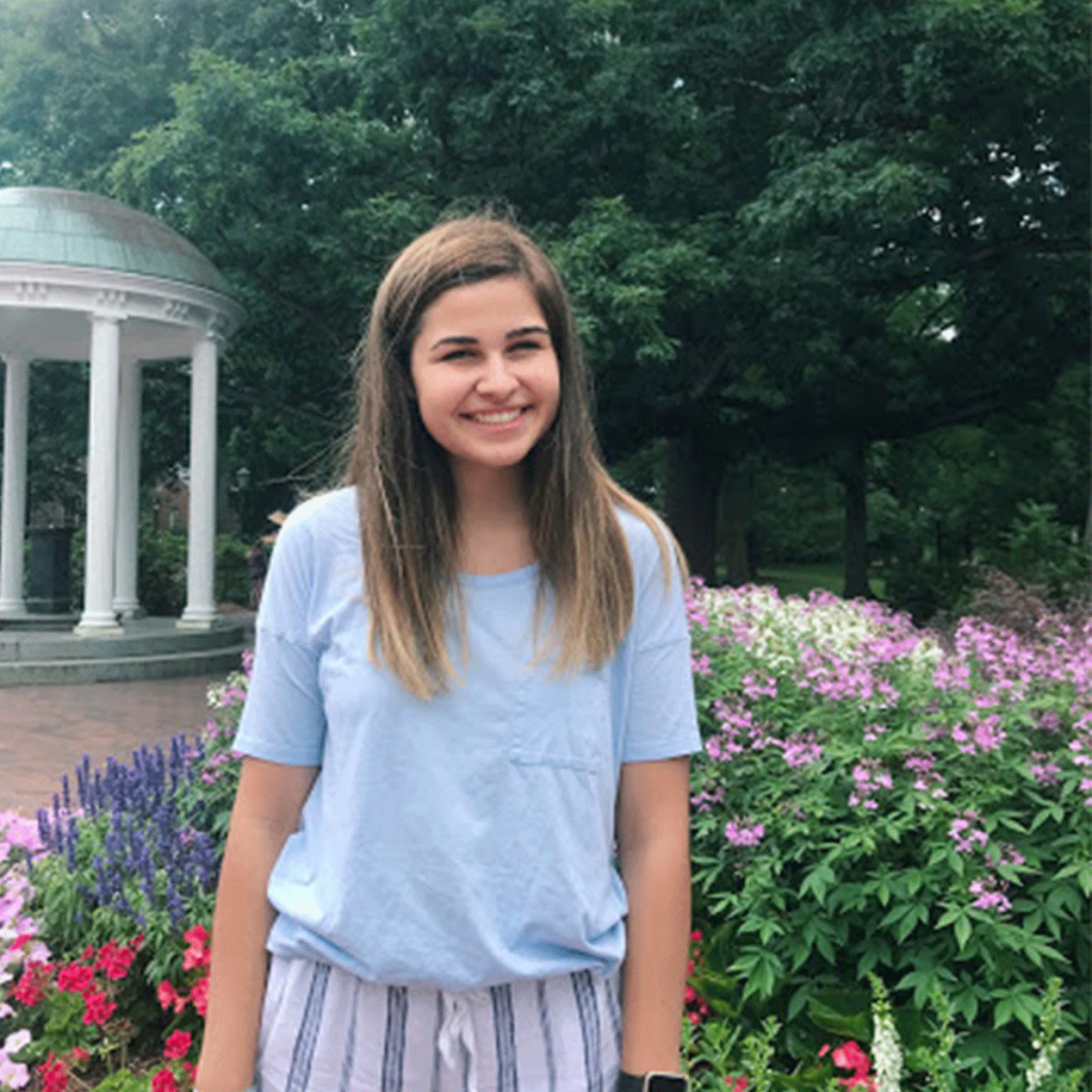 Photo of first-year Alyssa Floyd next to the Old Well