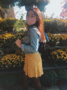 Yenah standing in a garden