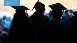 Carolina graduates in shadow